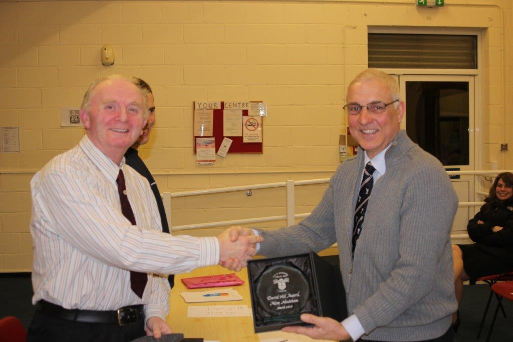 Alan Newnham receiving his award