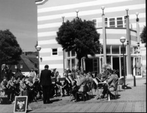 Playing outside the town hall at Plauderhausen, Germany 1995